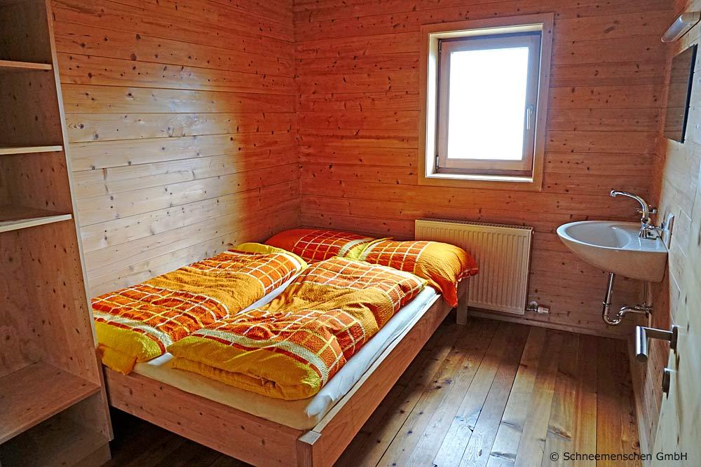 Blick in ein Doppelzimmer in der Hochsteinhütte