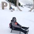 Frau beim Rodeln auf der RudiRun im Skigebiet Plose