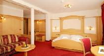 Junior Suite im Hotel Alpenheim in St. Ulrich