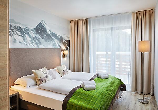 Alpenwohnen.L - Schlafzimmer - Wohnbeispiel